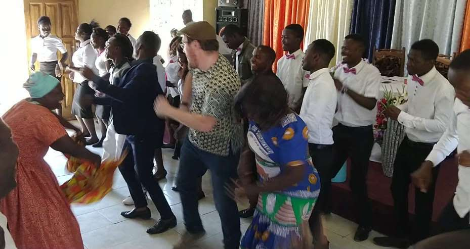 Zambia YAV Miguel dancing with church members of all ages at his congregation's heartfelt farewell to him.