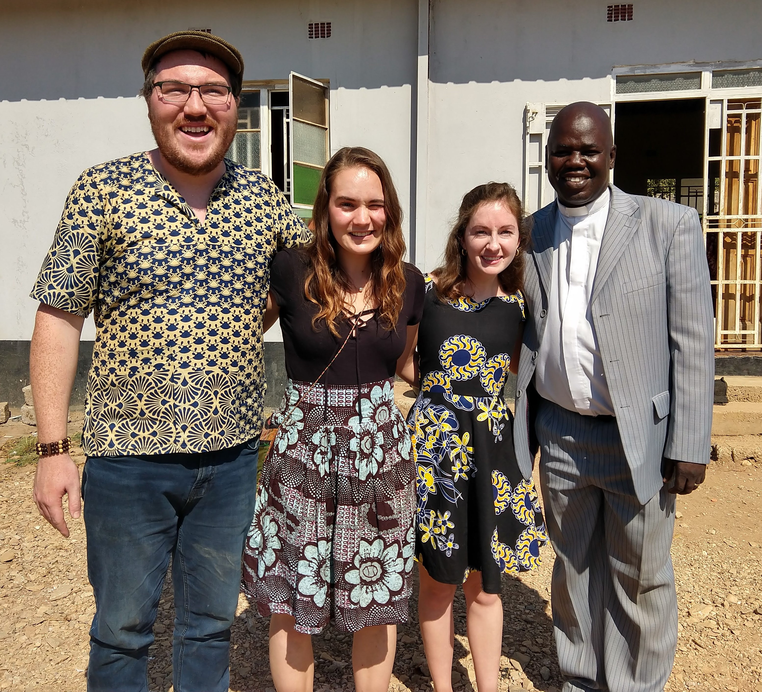 Zambia YAVs Miguel, Sophia, and Emily in a final photo with Rev. Daniel Tembo. Emily has decided to remain for a second year in her Zambian community.