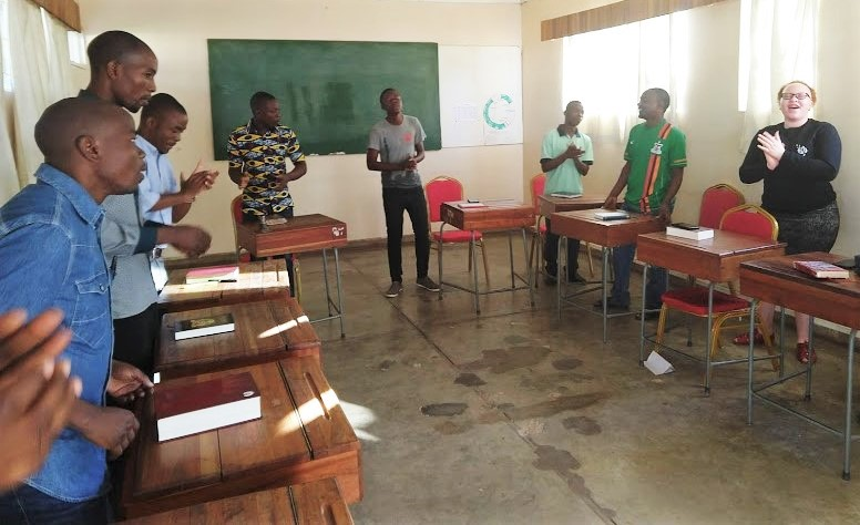 Members of Dustin's Paul class, here singing early in the morning before classes begin.