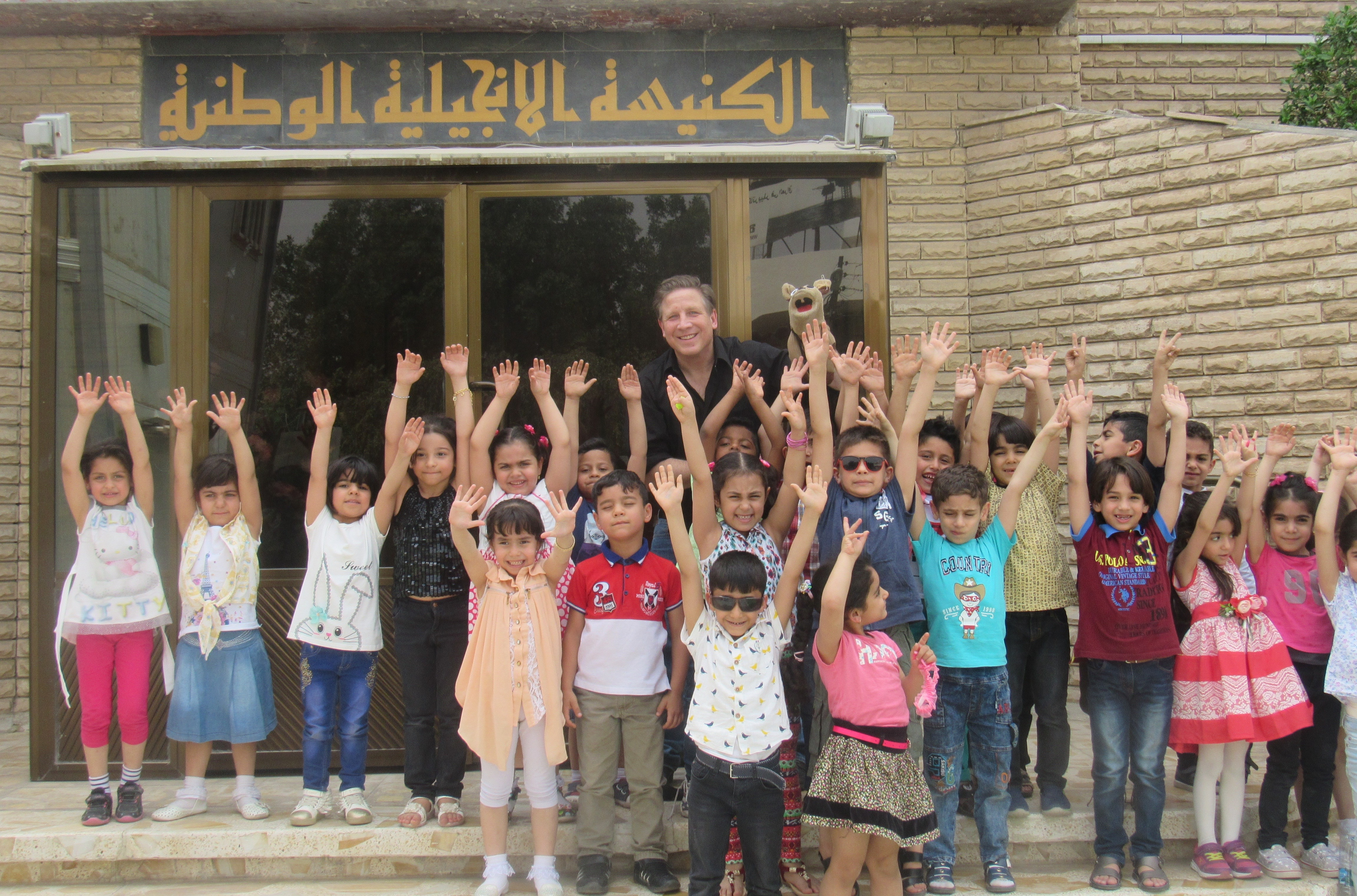 Kids at the kindergarten in Basrah, Iraq, reaching for the stars. (Photo by Scott Parker)