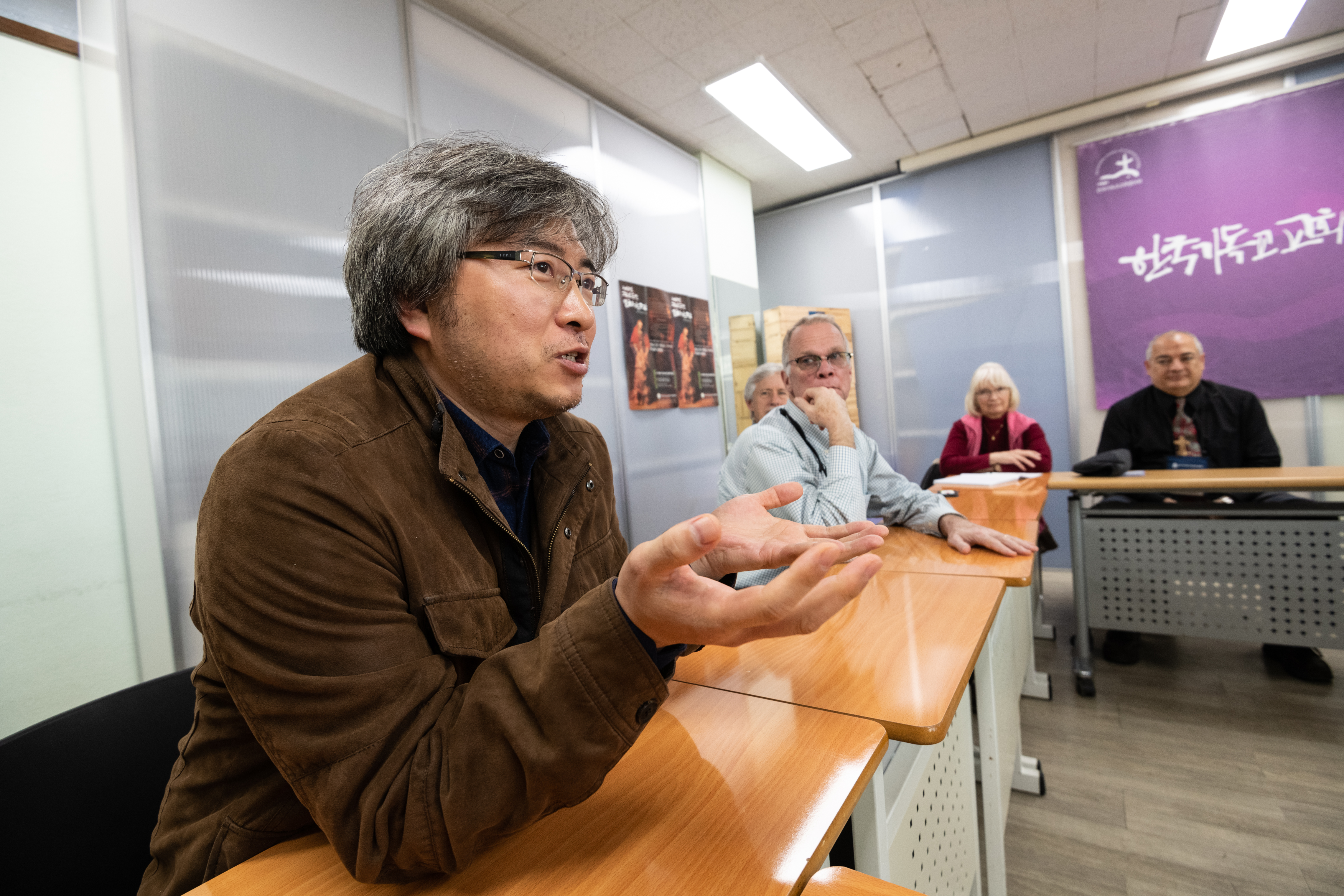 The Rev Hye-min Roh, program director for the Reconciliation and Unification Department of the National Council of Churches in Korea (NCCK), speaks with Presbyterian Peacemaking Travel Study Seminar participants. (Photo by Gregg Brekke)