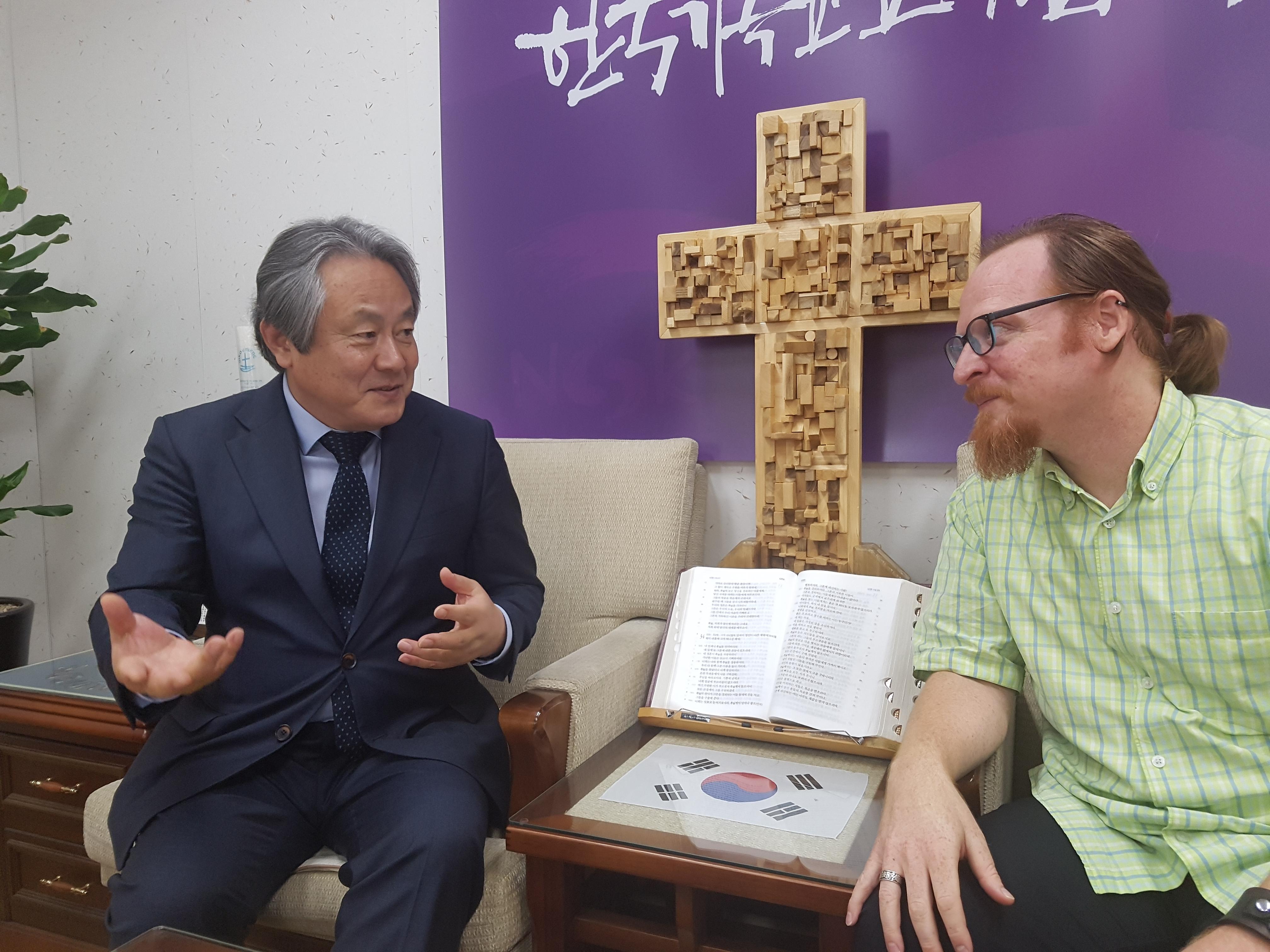 Rev. Lee Hong-jung sharing stories of his visit to North Korea with Kurt.
