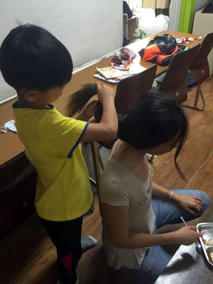 Alyson Good News – Alyson and a different boy from her placement agency bond over hair braiding