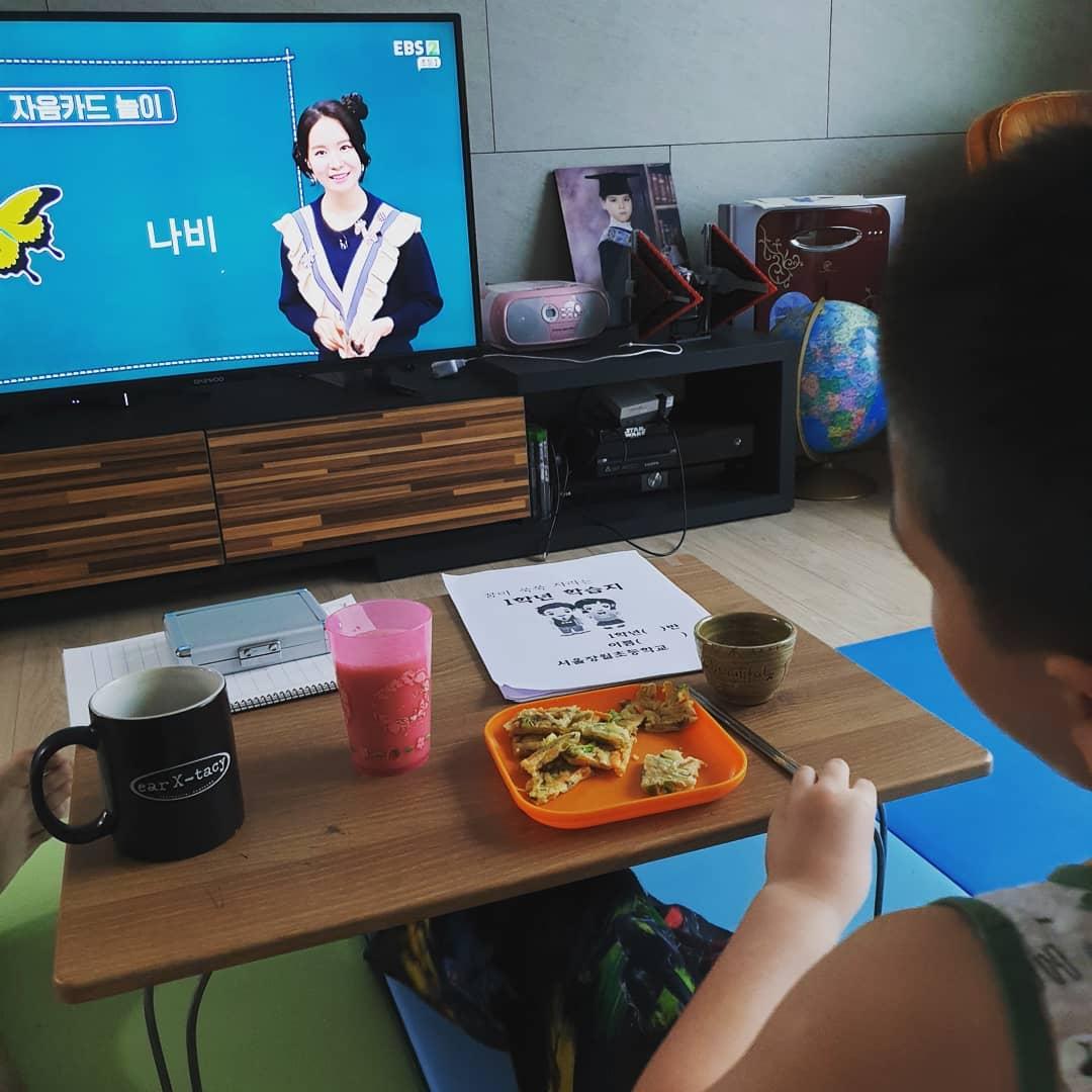 Sahn is participating in a virtual class through a TV channel.