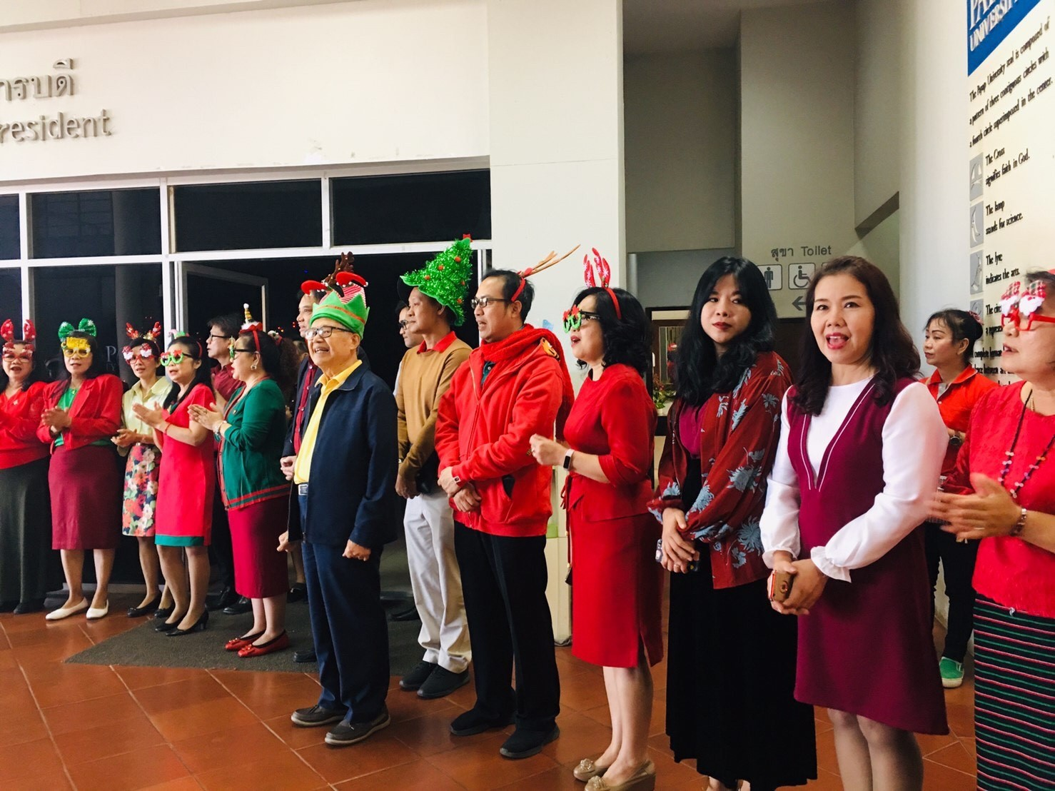 Christmas caroling at Payap University--in front of the president's office.