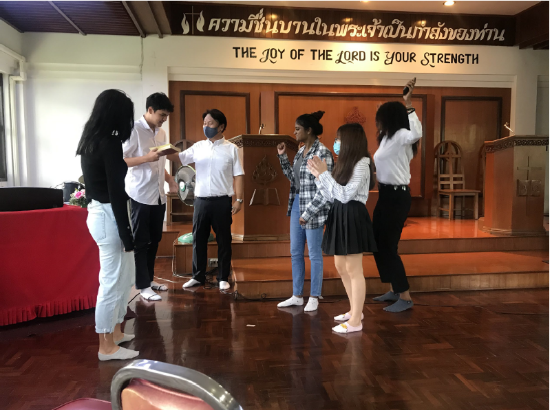 International program students doing a skit about how to find a win-together solution to a conflict in the dorm—they had fun.