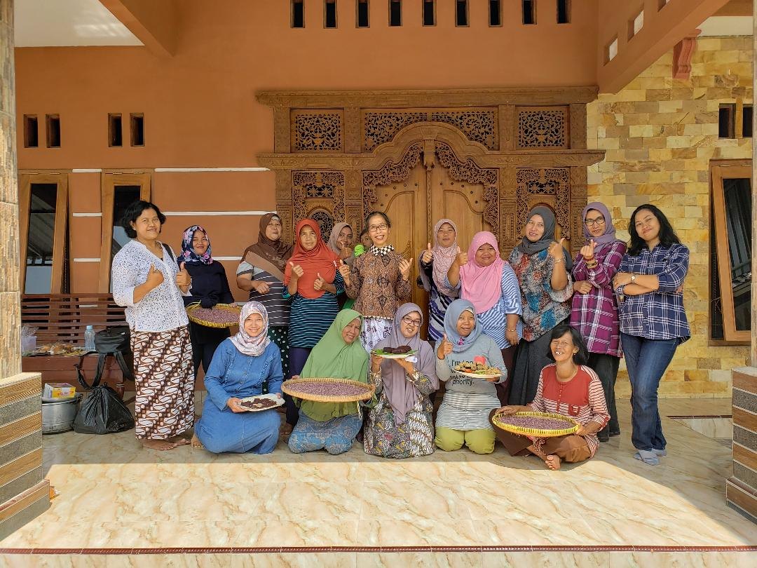 With participants and facilitators after training to make flour and products from purple yam.