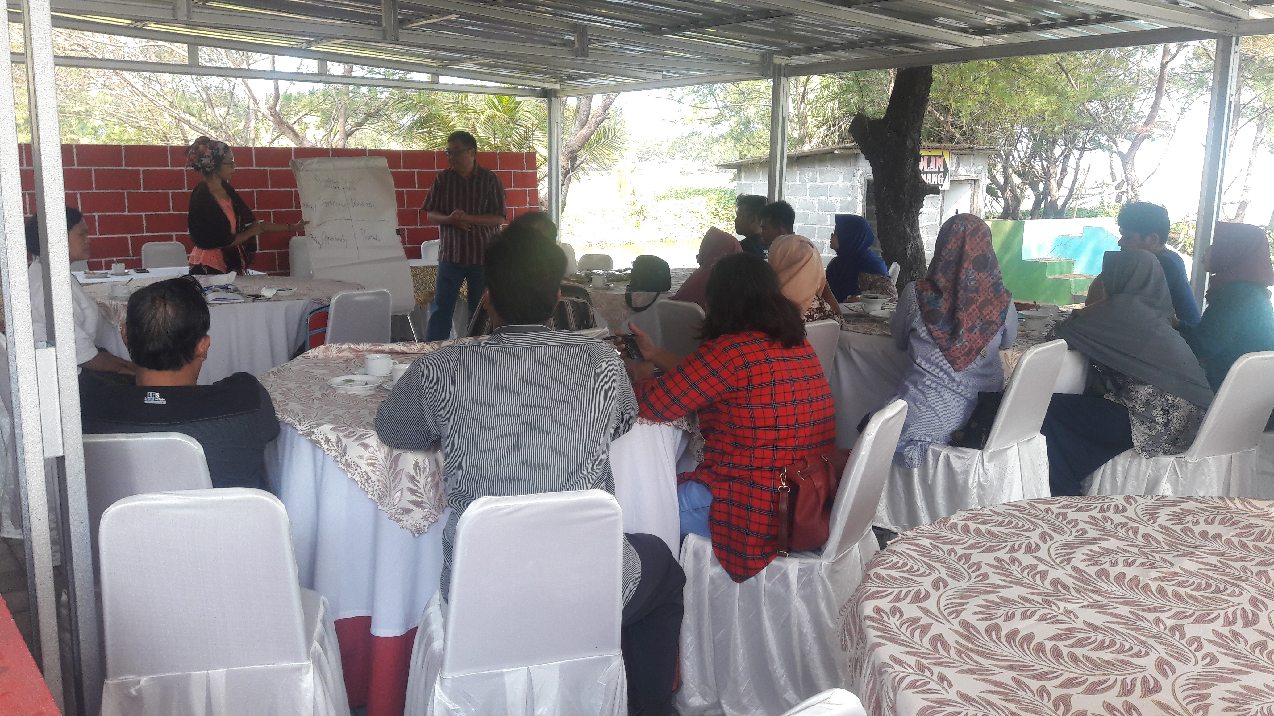 Dr. Singgih Santoso and Farsijana facilitate a training for the airport area co-op.
