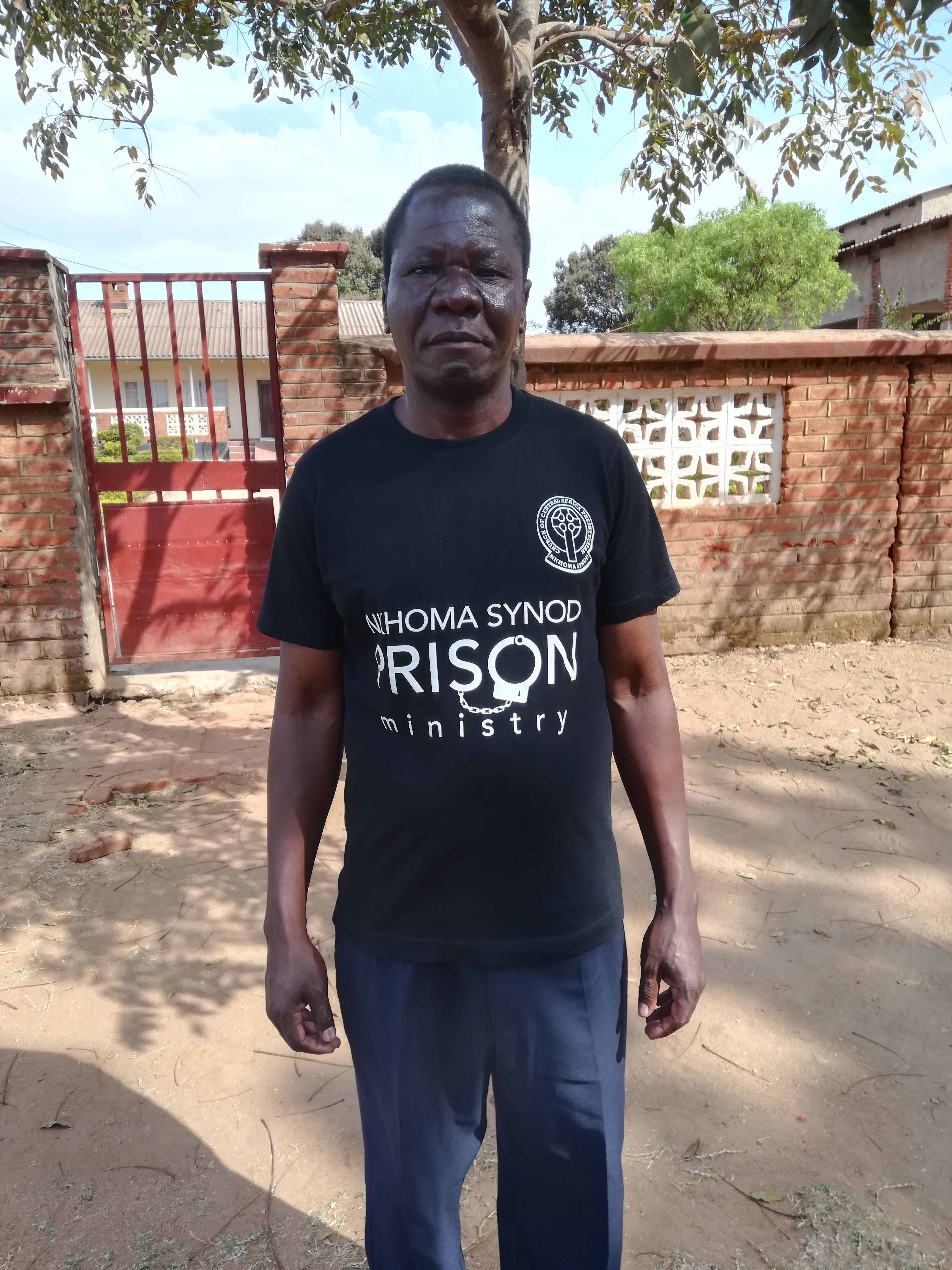 Rev. Wickliff Zulu wearing the Prison Ministry t-shirt for a visit to Kachere Youth Prison.