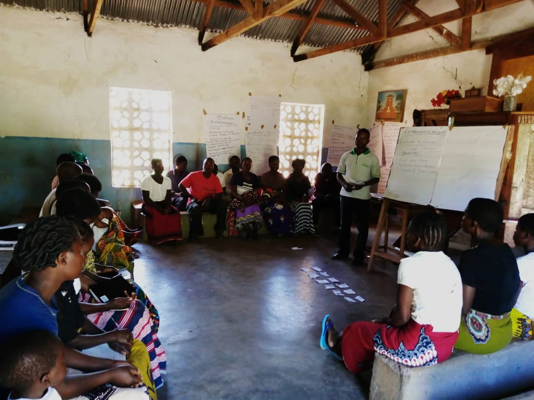 William Chimwezi facilitating a CHE Committee training for a new village.