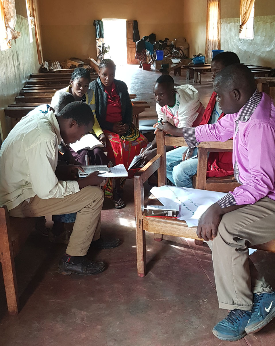 CHE home visitors doing group work inside the Emusa Church.