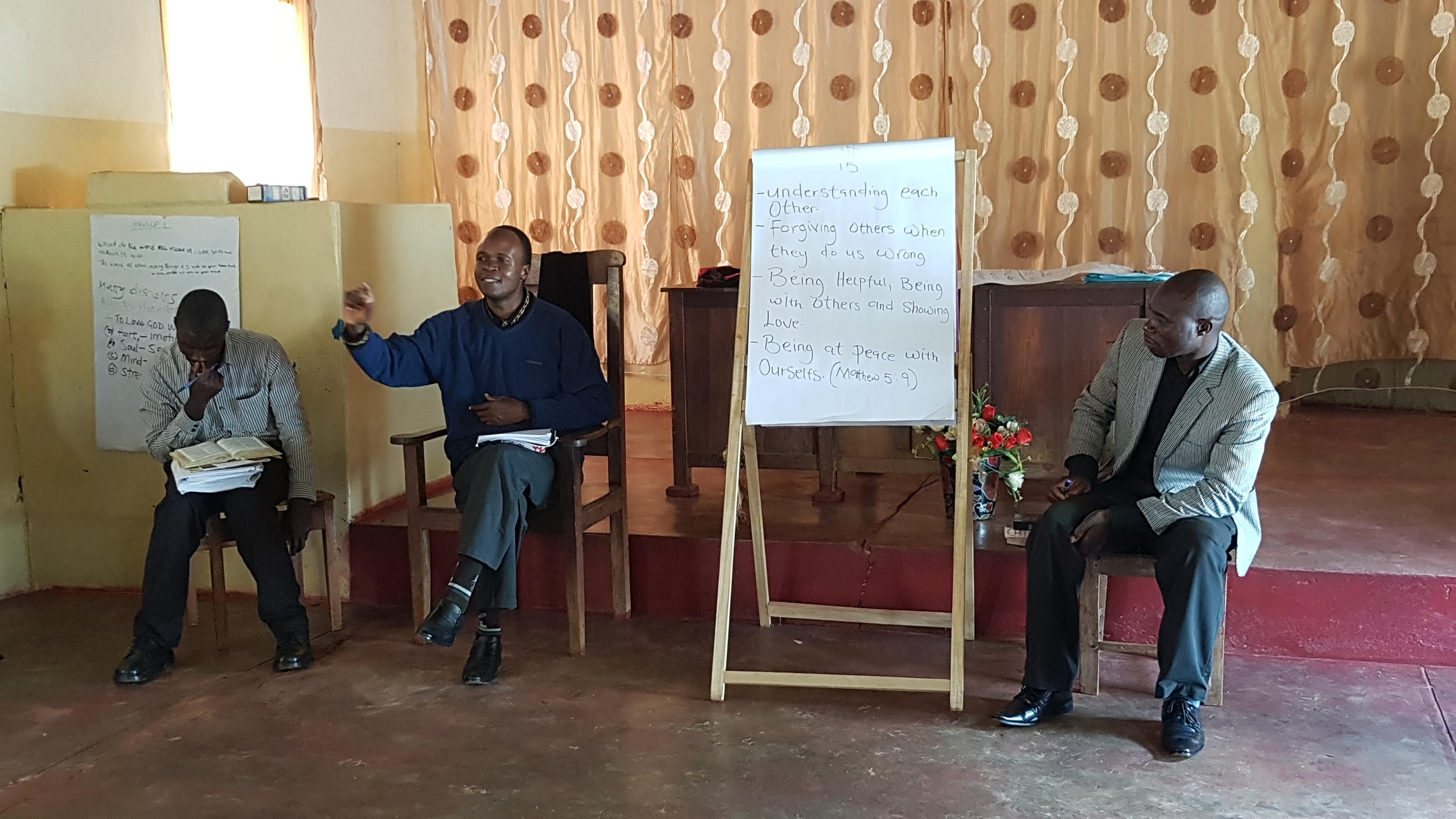 Rev. Chilenje facilitating a CHE lesson.