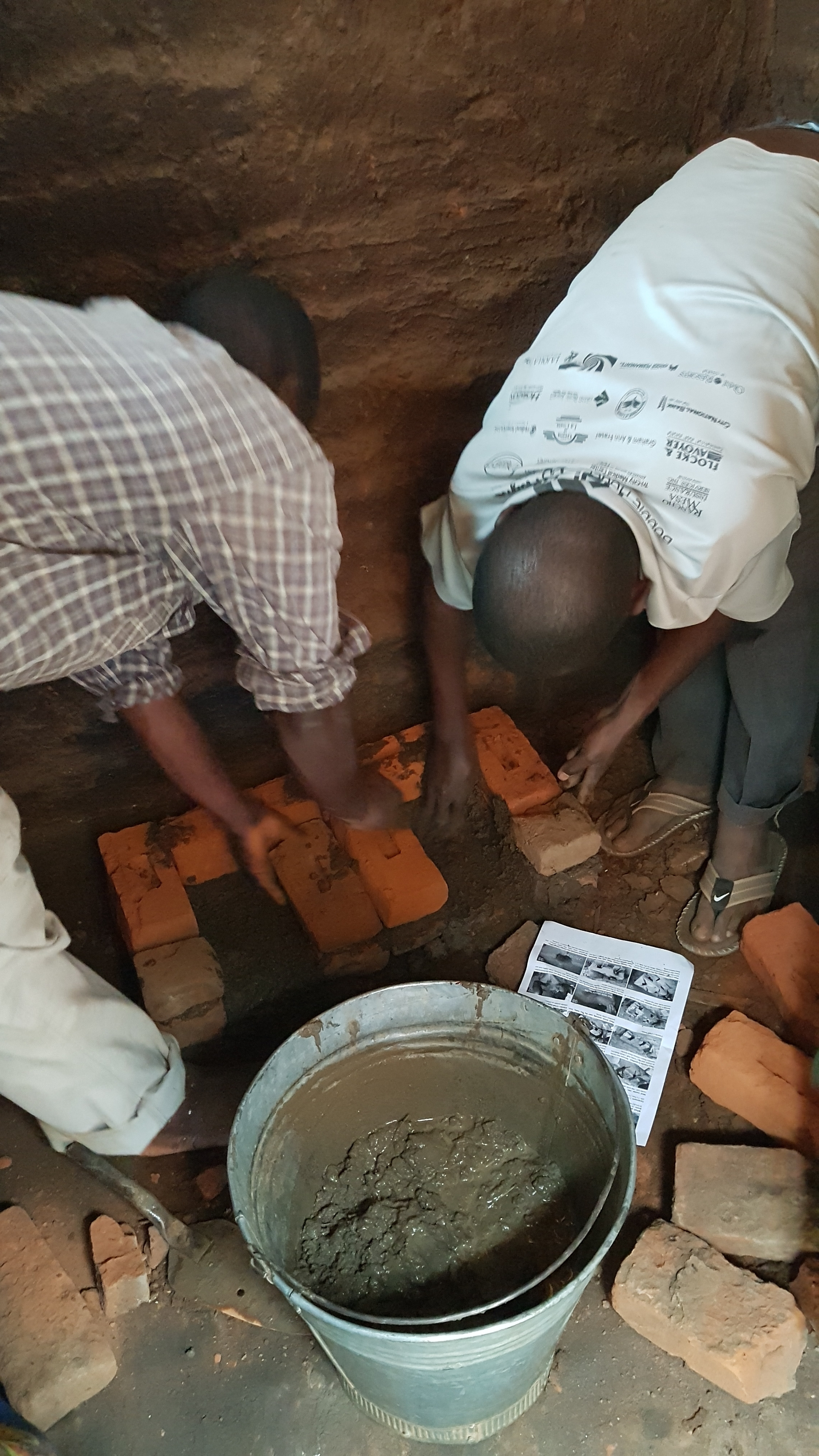 Laying the bricks.