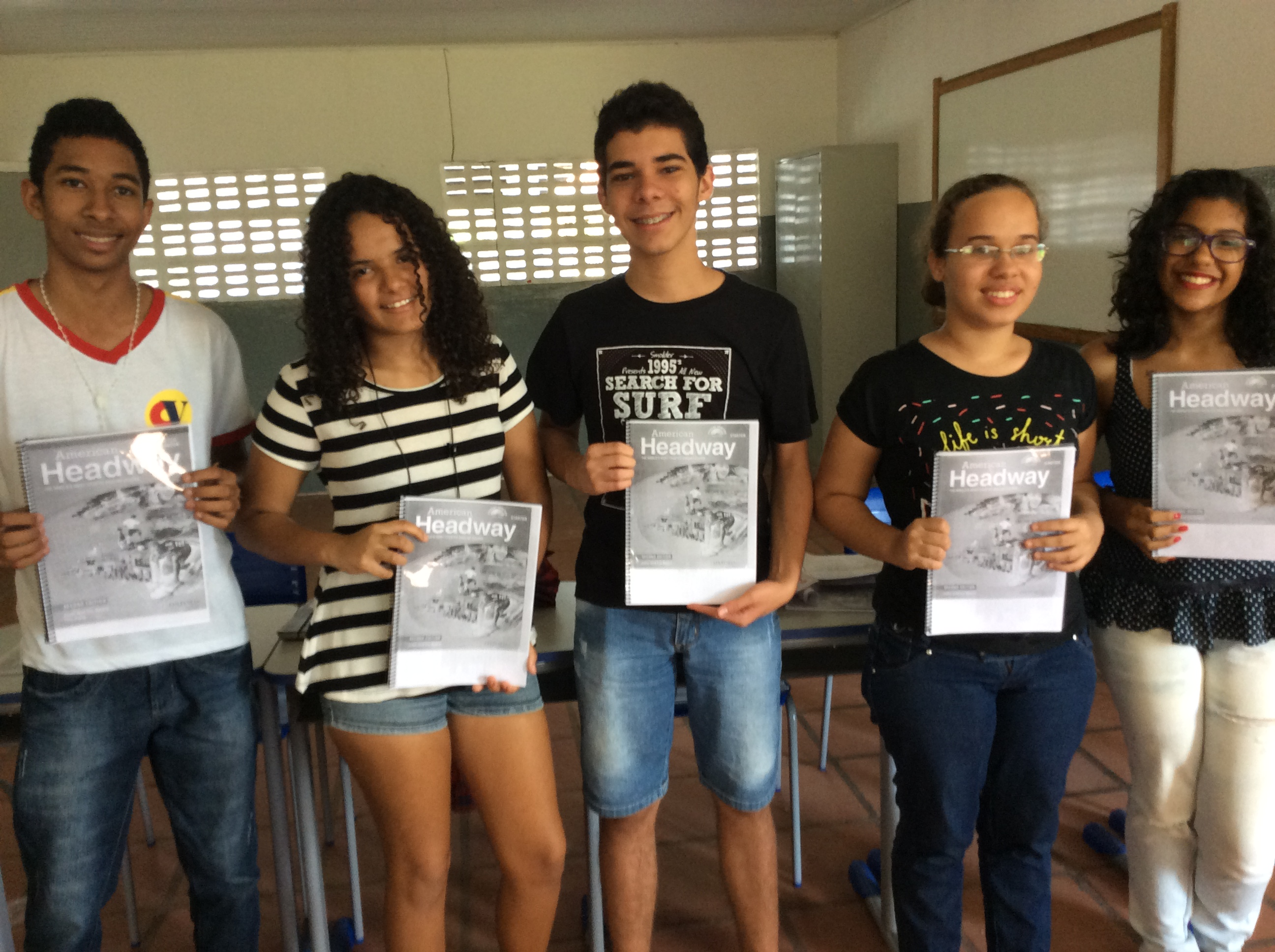 The middle school English students, displaying their textbooks