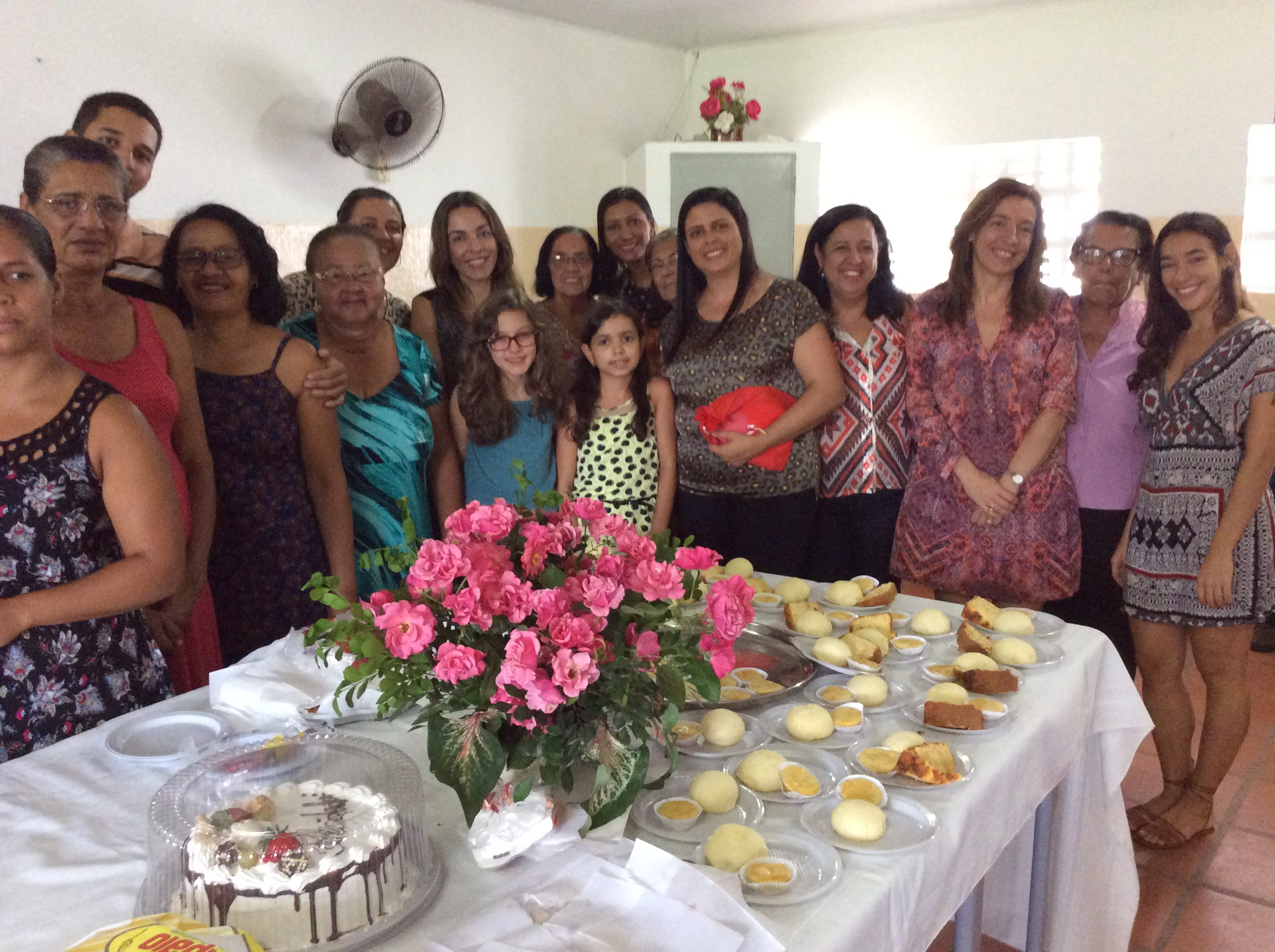 There were so many mothers in a small room that we couldn't fit them into one picture! These two pictures are of the mothers and children at the party.