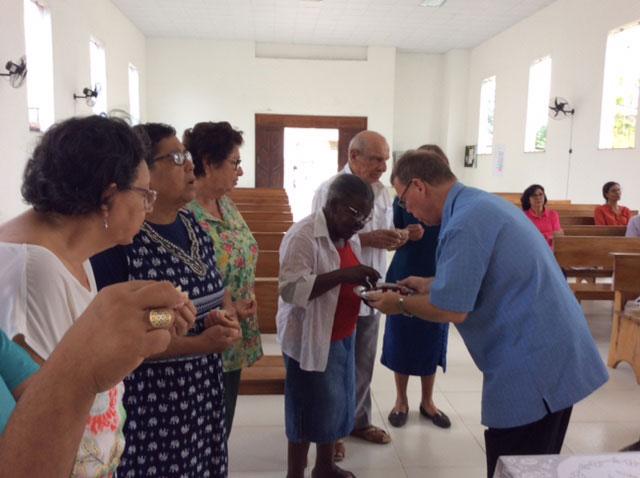 Gordon serving Holy Communion after Sunday school.