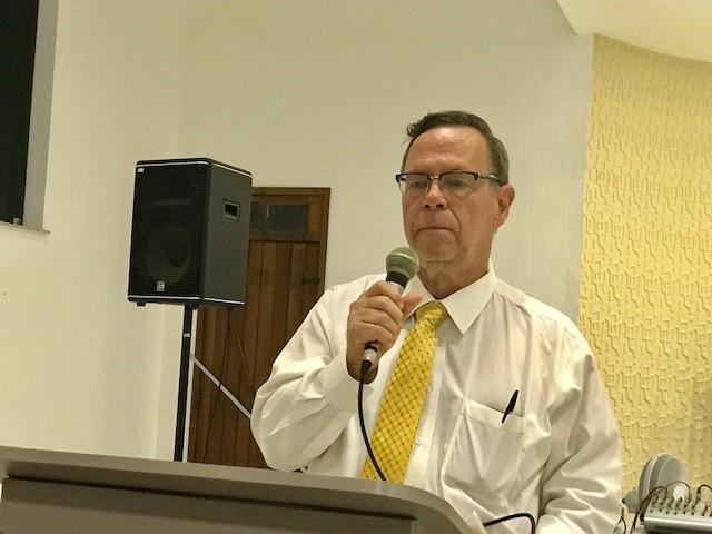 Gordon, teaching in church.