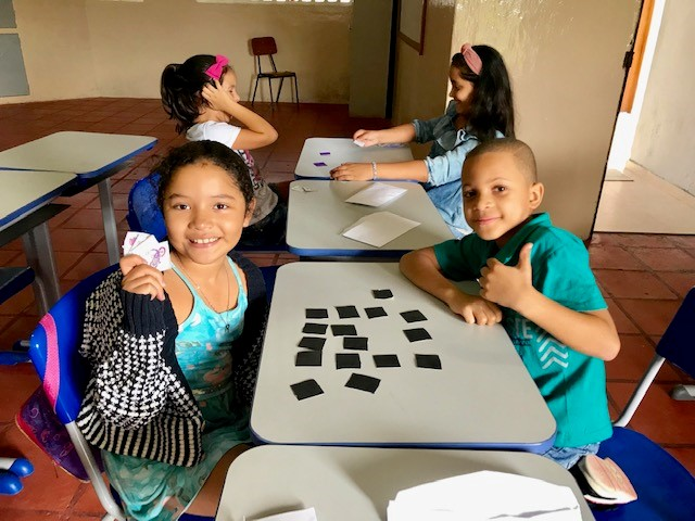 Children using flash cards to enrich their English vocabulary.