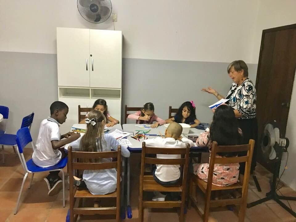 Dorothy teaching the children during worship.