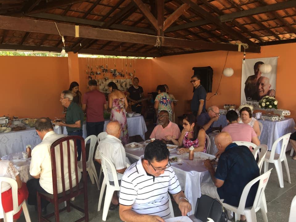 People enjoying lunch at the celebration for Eliseu and Vane.