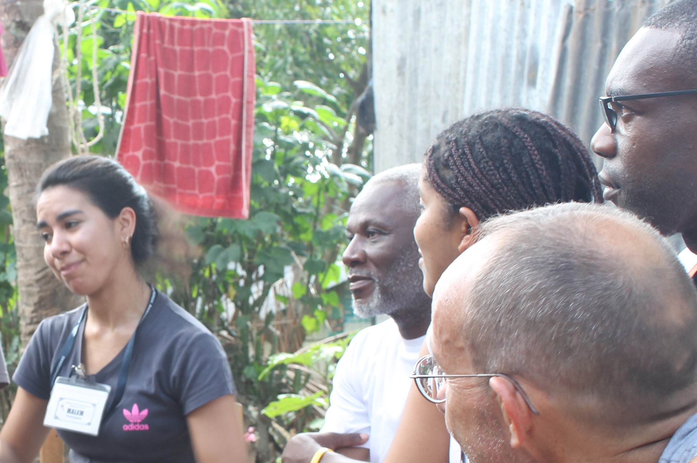 Juan Batista (far right, behind Mark's head) and Bellanira Matos (just left of Juan) watching a fellow CHE student from Chile (far left) carry out a health lesson with a group of children who are part of a CHE Children's Club in Mombin Crochu. Our host and director for the Haiti CHE program, Osse Saint-Juste, sits between Bellanira and the Chilean CHE student.