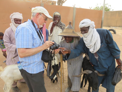 Richard Haney, visiting Niger from Presbyterian Frontier Fellowship, showing pictures to new friends who had never before seen a digital camera.