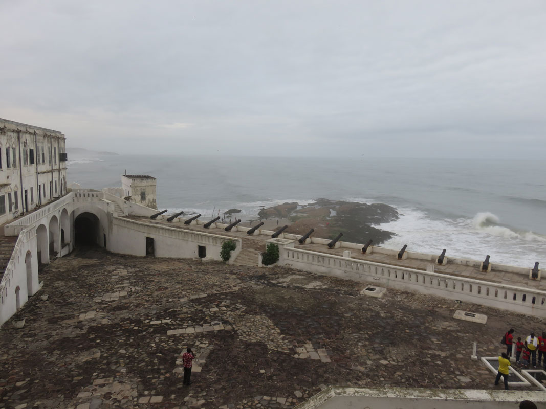 """Looking down from the upper floors of Cape Coast Castle. The """"Door of No Return,"""" where captives were loaded onto ships, is located in the large dark archway."""