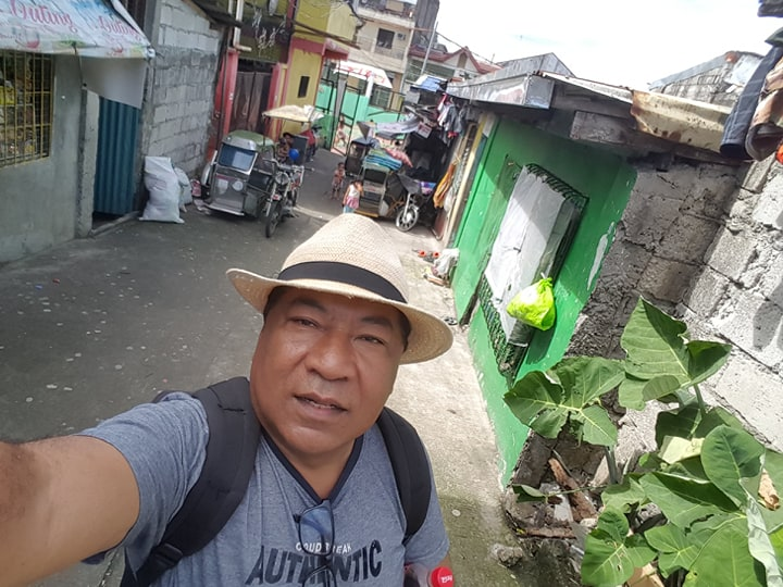 Hery Ramambasoa outside a house near Manila where two fathers, who both claimed their innocence, were killed by a gunman as part of the War on Illegal Drugs.