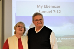 Eric and Becky bid farewell to LCC by raising their Ebeneezer