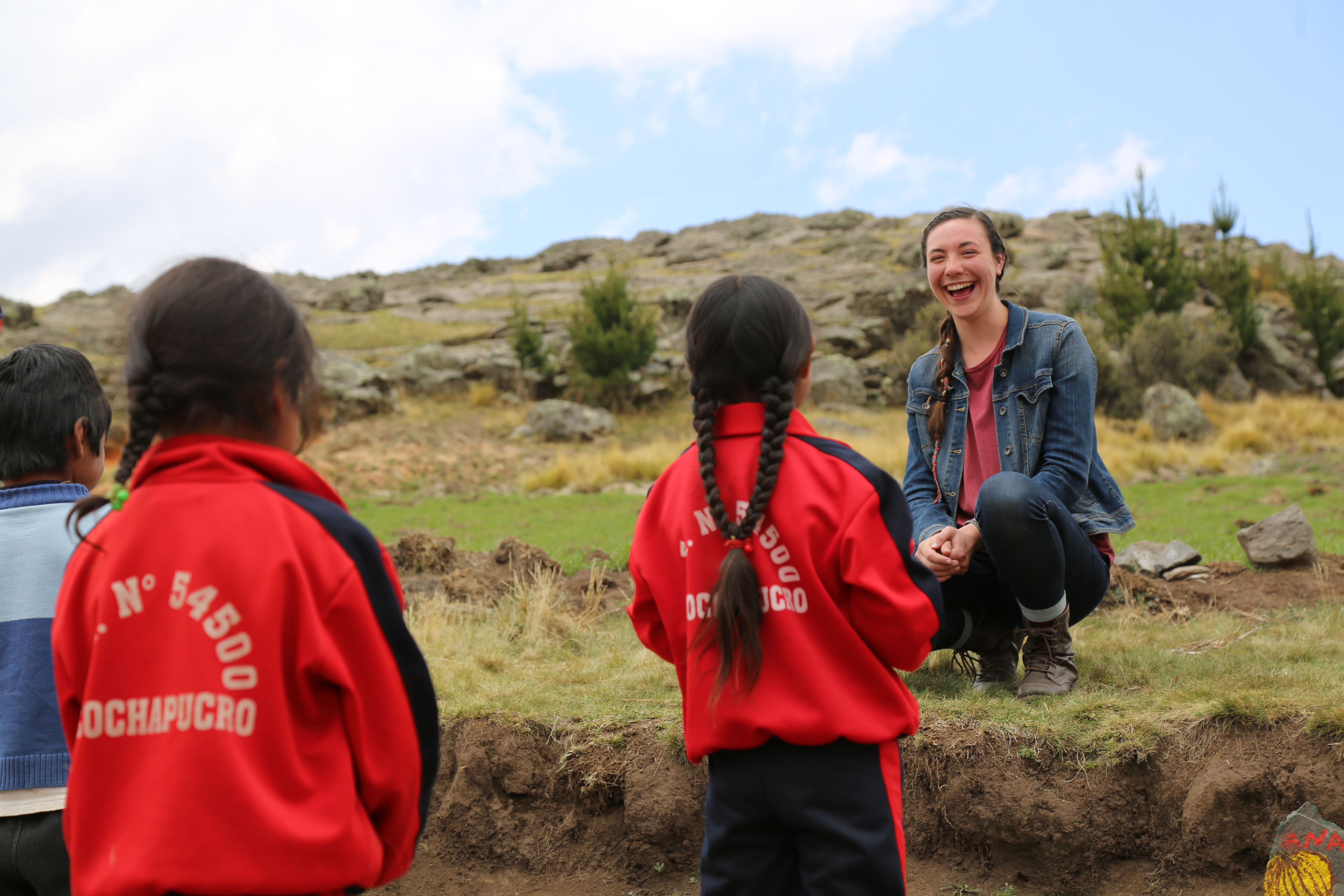 Young Adult Volunteer Alyson Miller, serving in Andahuaylas, Peru, stops to chat with school girls on her way to work. As part of their call to service, YAVs are challenged throughout the year to identify the many privileges they have and the ways they can work for justice and equality in the world.