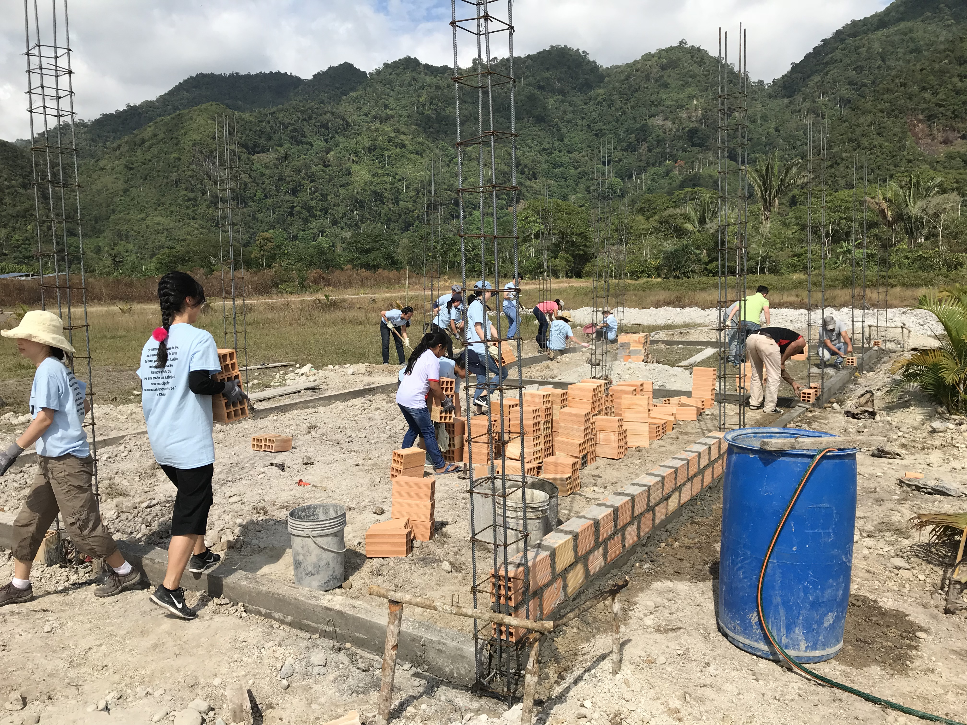 Youth and adults from the Korean Presbyterian Church of Westchester County (New Rochelle, NY) move in a load of bricks to start building the walls of the school in July.
