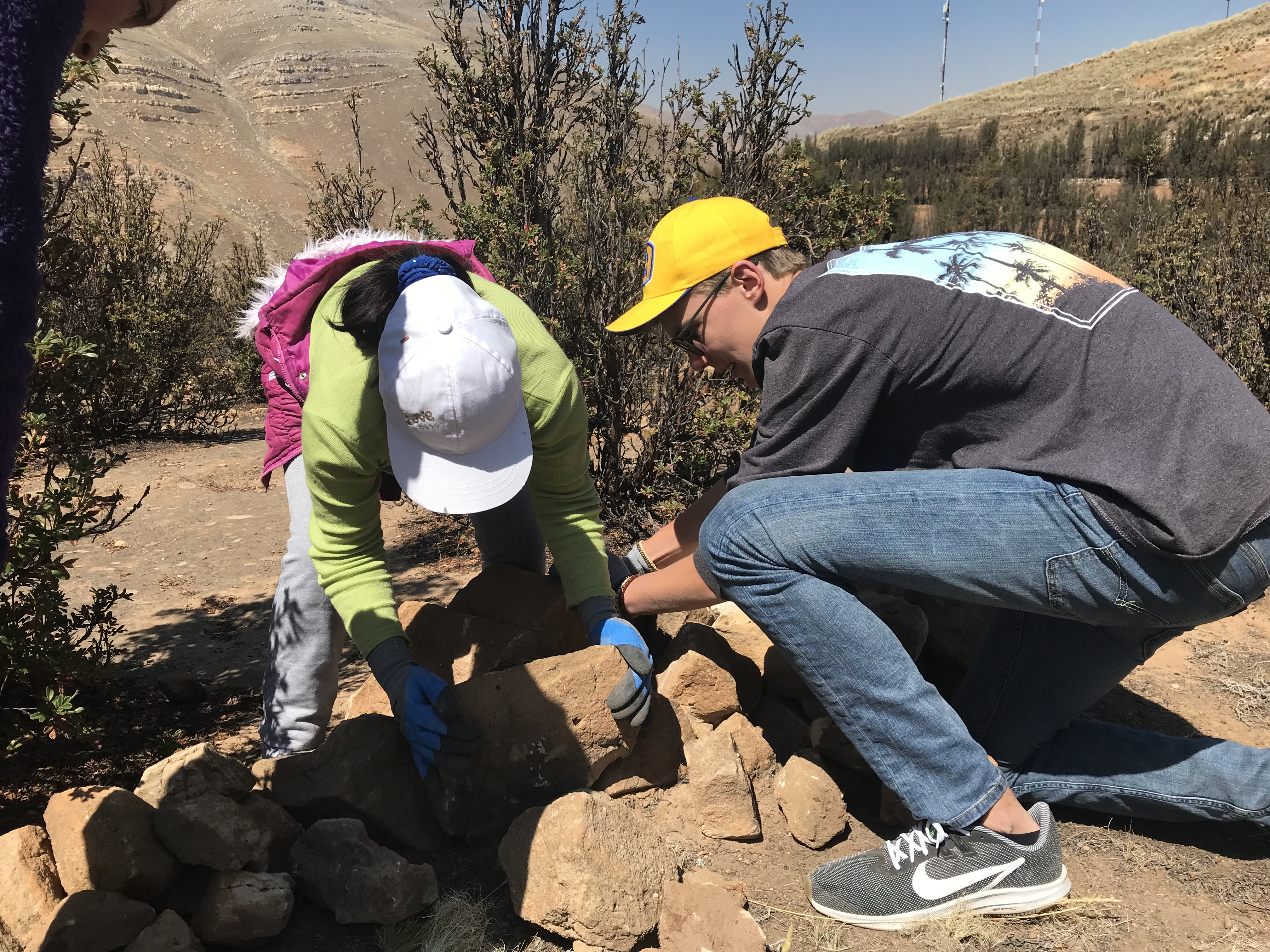 James Berthoud, youth member of the Covenant Presbyterian Church, works alongside youth from La Oroya in helping build terrace walls in the already forested lands of Villa El Sol.