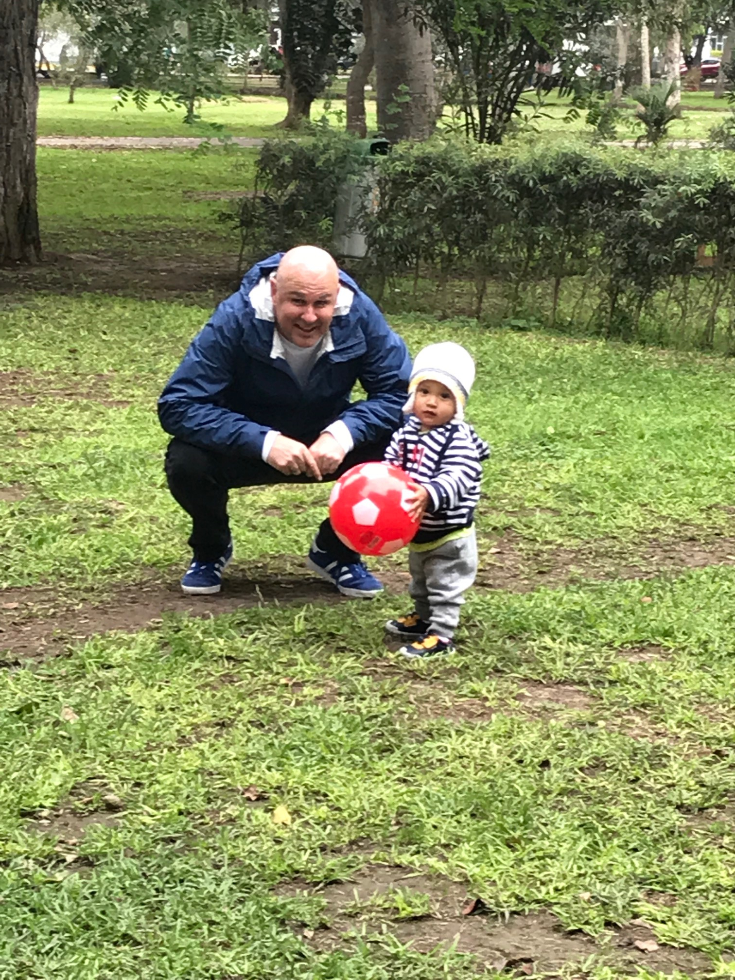 Thiago and Papá (Jed) enjoy time in the park playing ball.