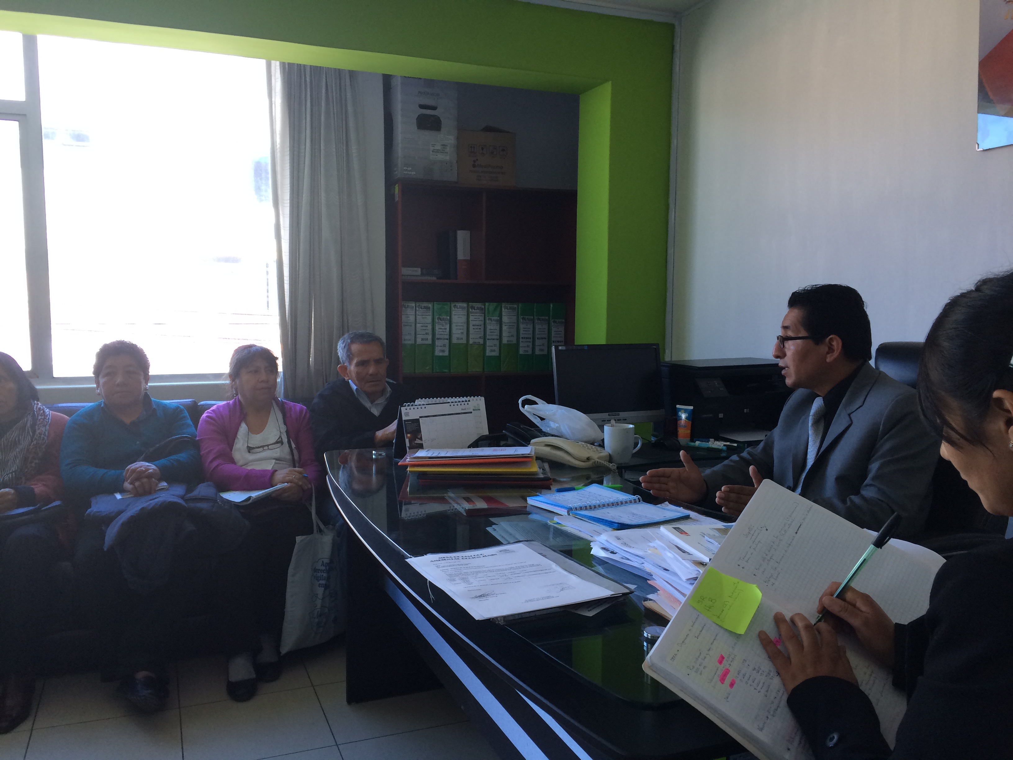 Conrado Olivera (director of Joining Hands network in Peru) and allies engage in conversation with the regional health director for La Oroya. (photo by Jed Koball)