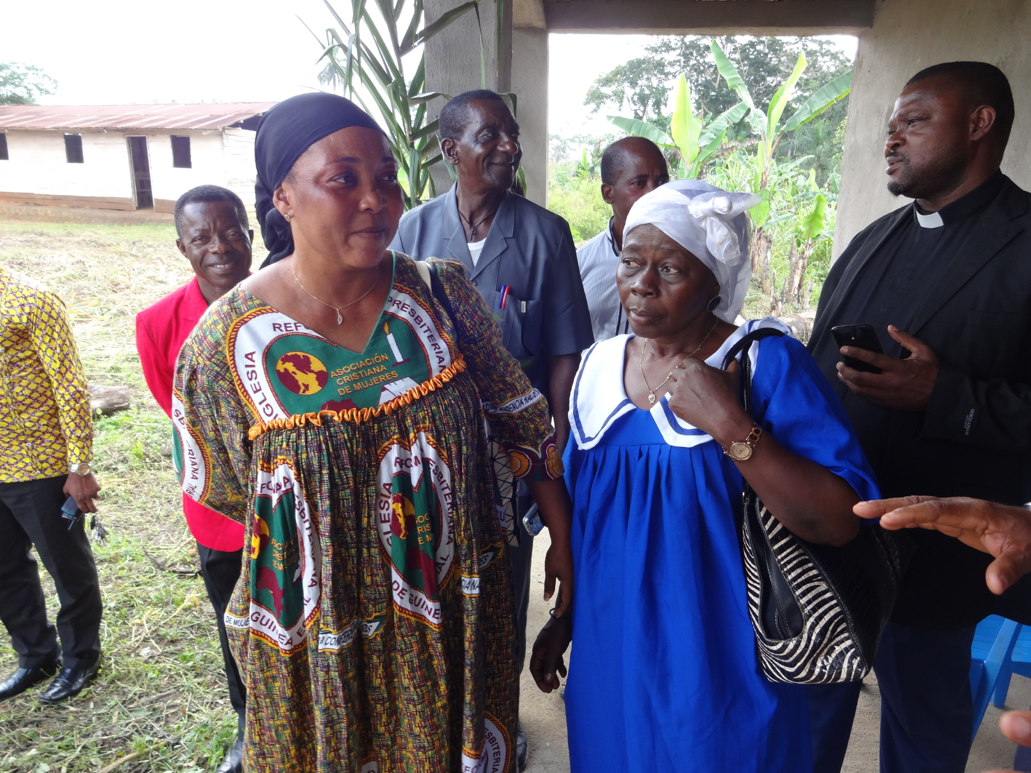 Mrs. Ana María OBONO with an elder of the Mokomo EFAK congregation taking visitors on a tour of one of the three community health centers being built by the Association of Christian Women of the Reformed Presbyterian Church of Equatorial Guinea.