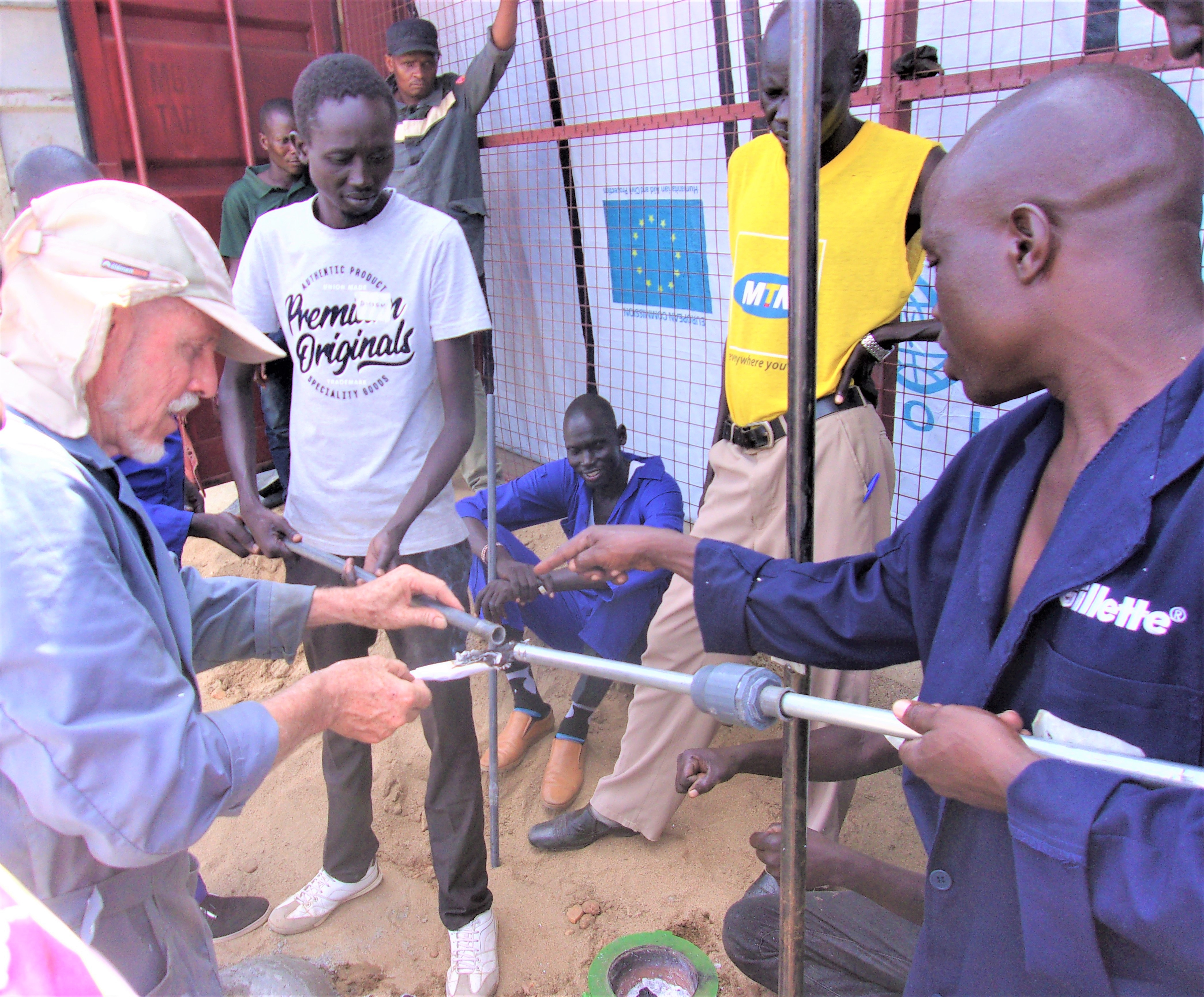 Henk Holtslag installing an EMAS hand pump with participants of the Short Course for Self-supply Technologies.
