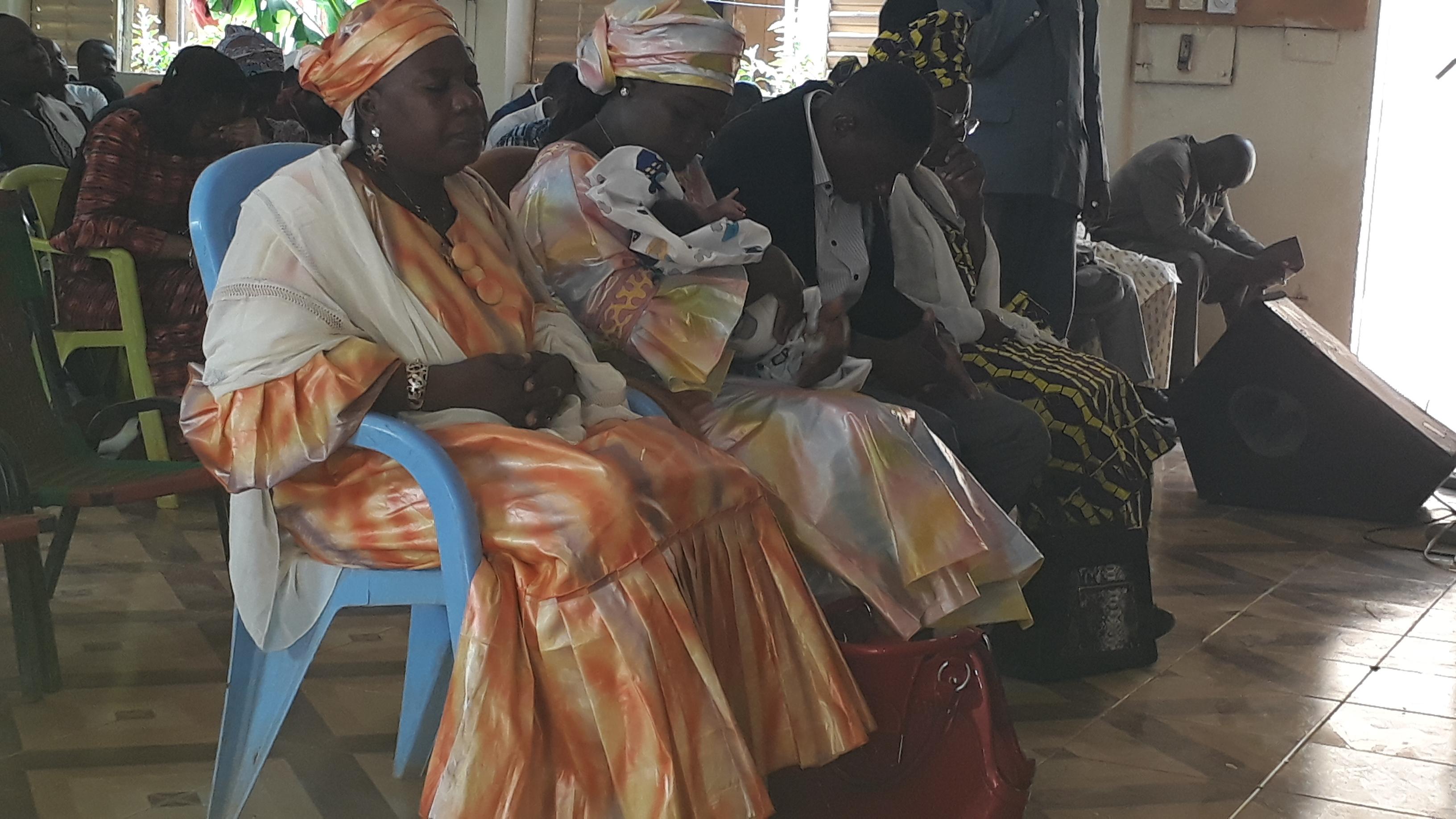 The family prays at Joshua's naming ceremony.