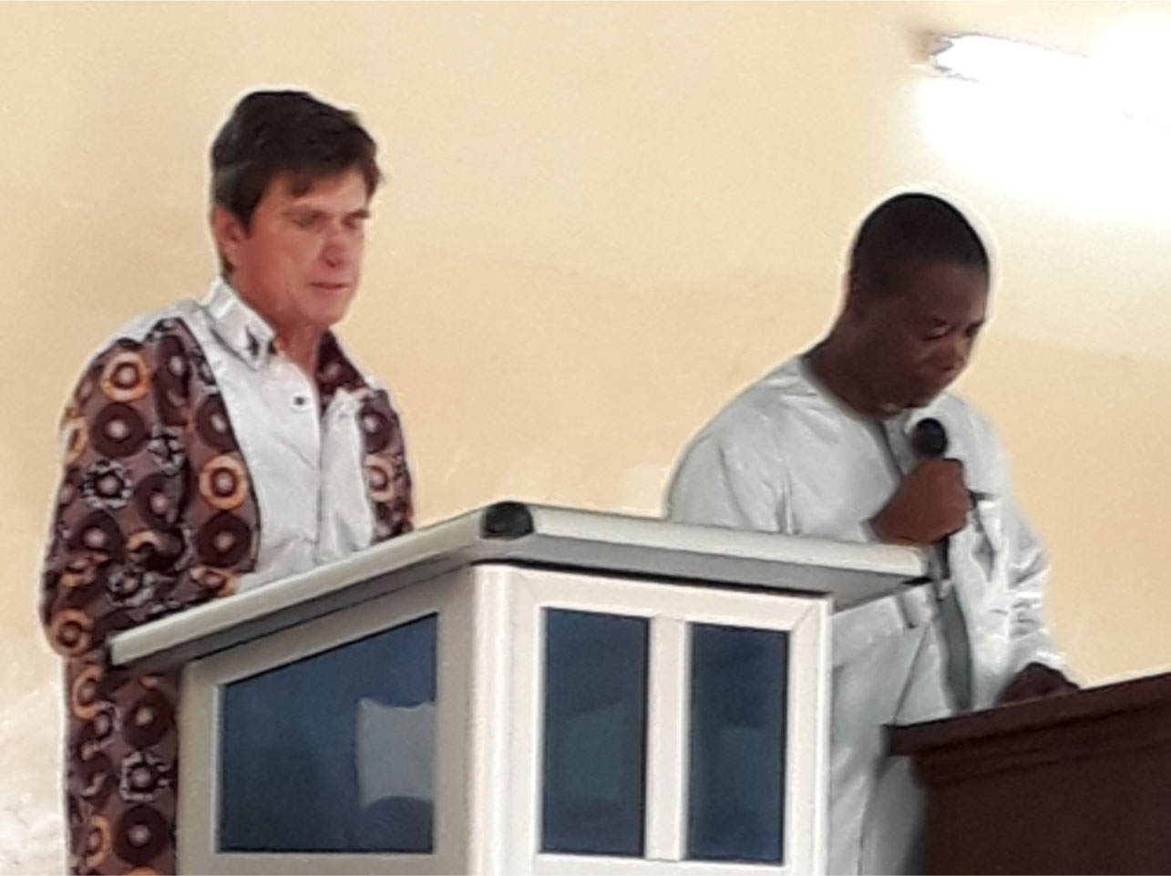 Jim preaching at our congregation, named Bokoki congregation, with Judge Issaka Moussa translating into Hausa.