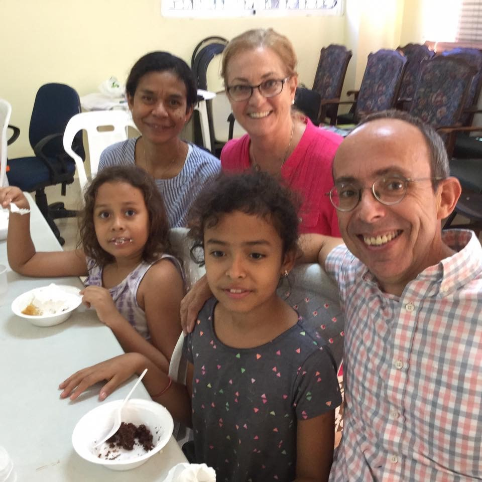 "Jenny Bent, Mark Hare, Keila and Annika Hare with Jo Ella Holman at their ""goodbye"" event in the national office of the Iglesia Evangelica Dominicana. (Photo courtesy of Jo Ella Holman)"
