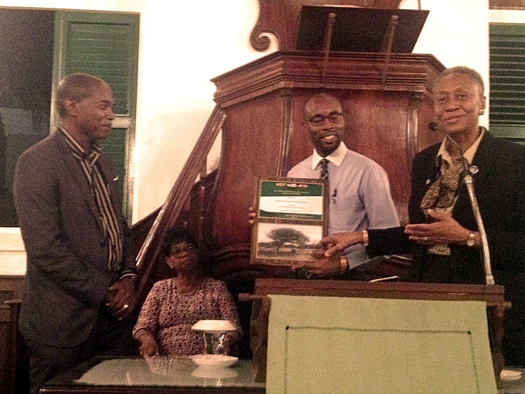 CANACOM President Rev. Carlington Keen and Mission Secretary Mrs. Jennifer Martin thank Mr. Ralph James of the Reformed Church in Curaçao for hosting CANACOM (photo by Jo Ella Holman)