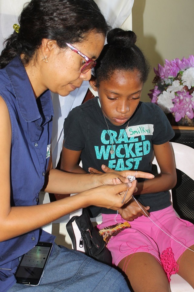 In another, women leaders work with many young girls in their community on needlework, building positive relationships and a sense of worth and safety for many. PC(USA) mission co-worker Jenny Bent has been a leader in these efforts.