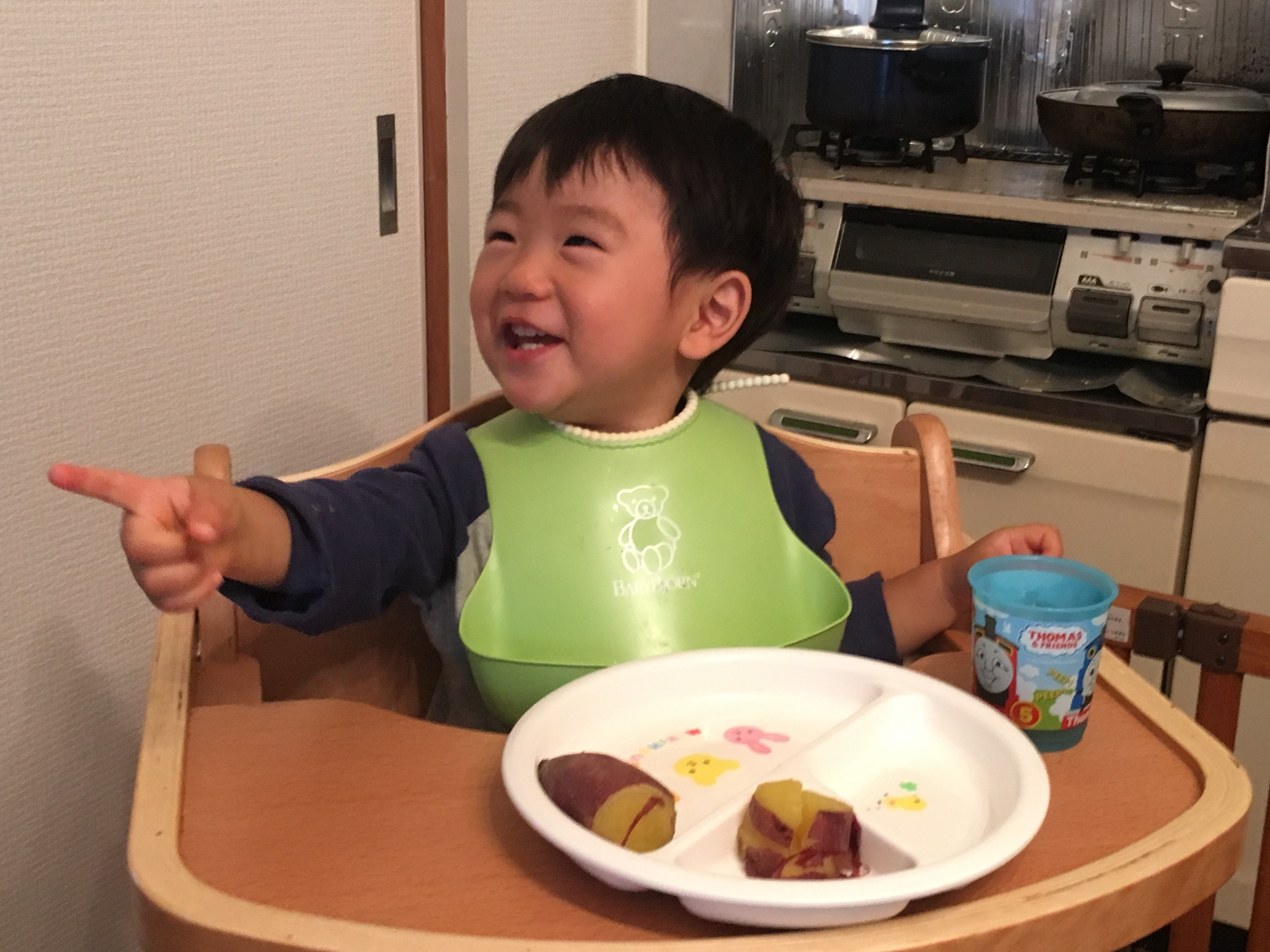 A happy boy with sweet potato.