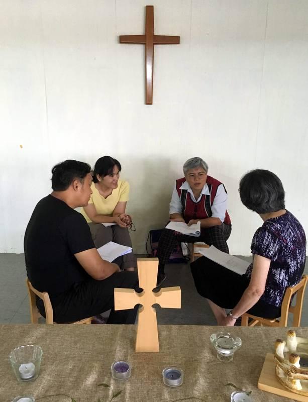 Small group sharing at retreat.