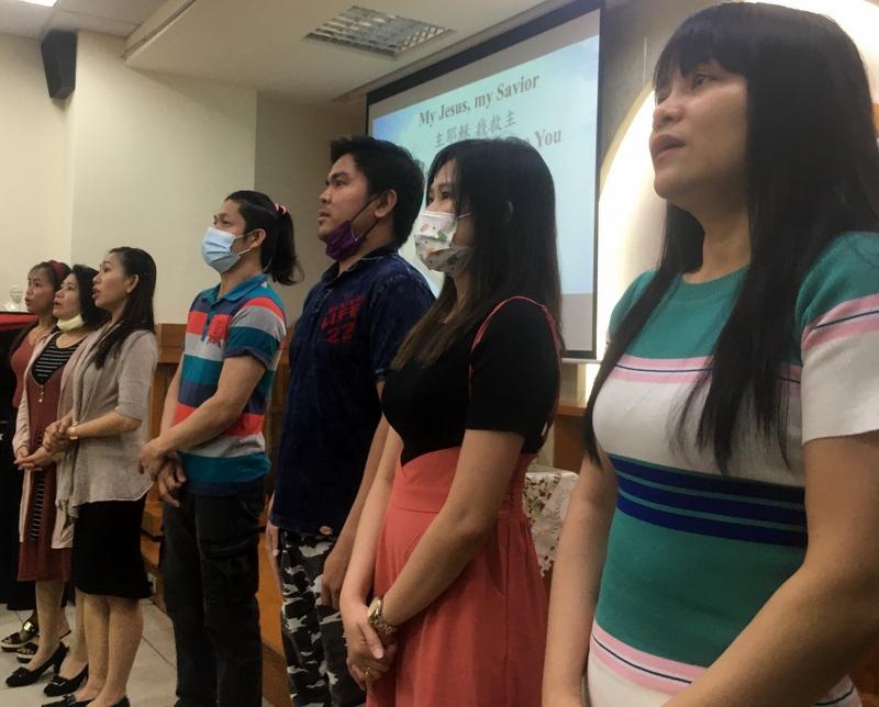 Filipino friends praise God in worship.