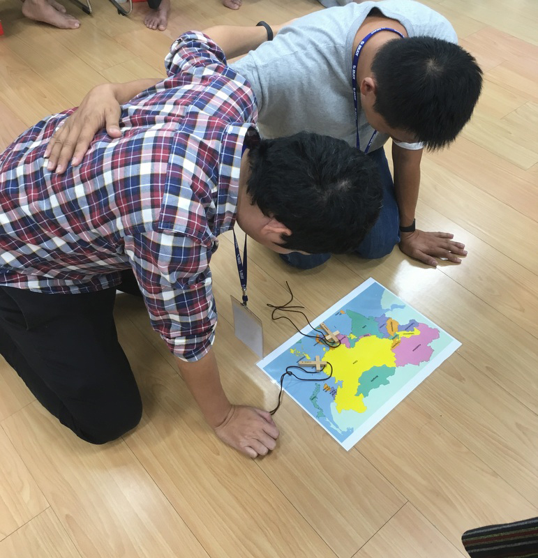 Prayer Partners from Thailand and Taiwan praying for the other's country and church.