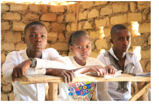 Children study in unfinished classrooms. Photo credit Jeff Boyd.