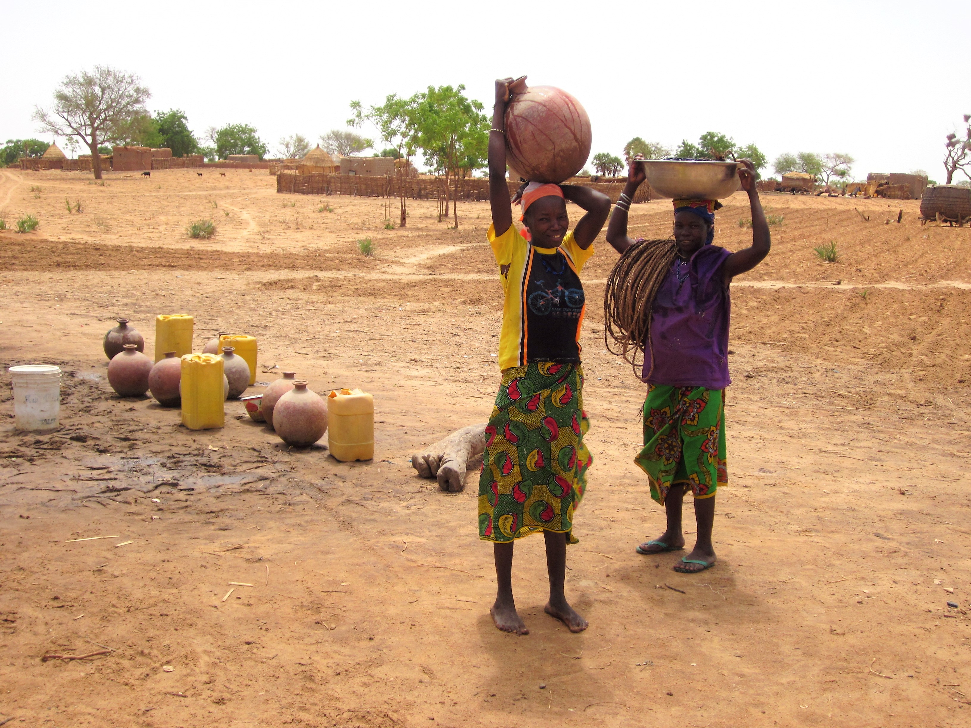 Girls in Niger who have been sent to the well to collect water for the family.