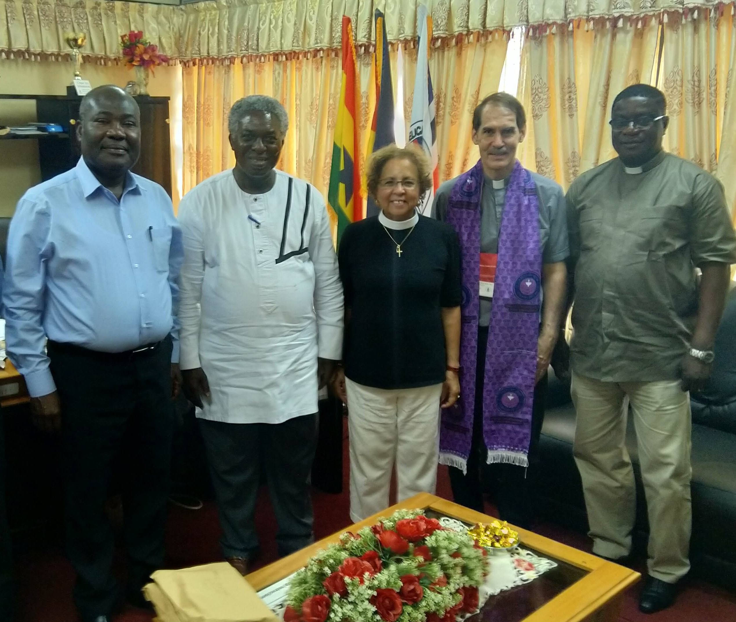 Rev. Yaw Frimpong Manso, former moderator of the Presbyterian Church of Ghana, who now serves a PC(USA) congregation in the Bronx (second from left); Sandy Lane, moderator of the Presbytery of New York City (center); and Rev. Robert Foltz Morrison, executive presbyter of the Presbytery of New York City (second from right) visiting Rev. Emmanuel Amey, clerk of the Evangelical Presbyterian Church in Ghana (far left), and Rev. Ken Djotefe (far right), ecumenical director of the Evangelical Presbyterian Church in Ghana.