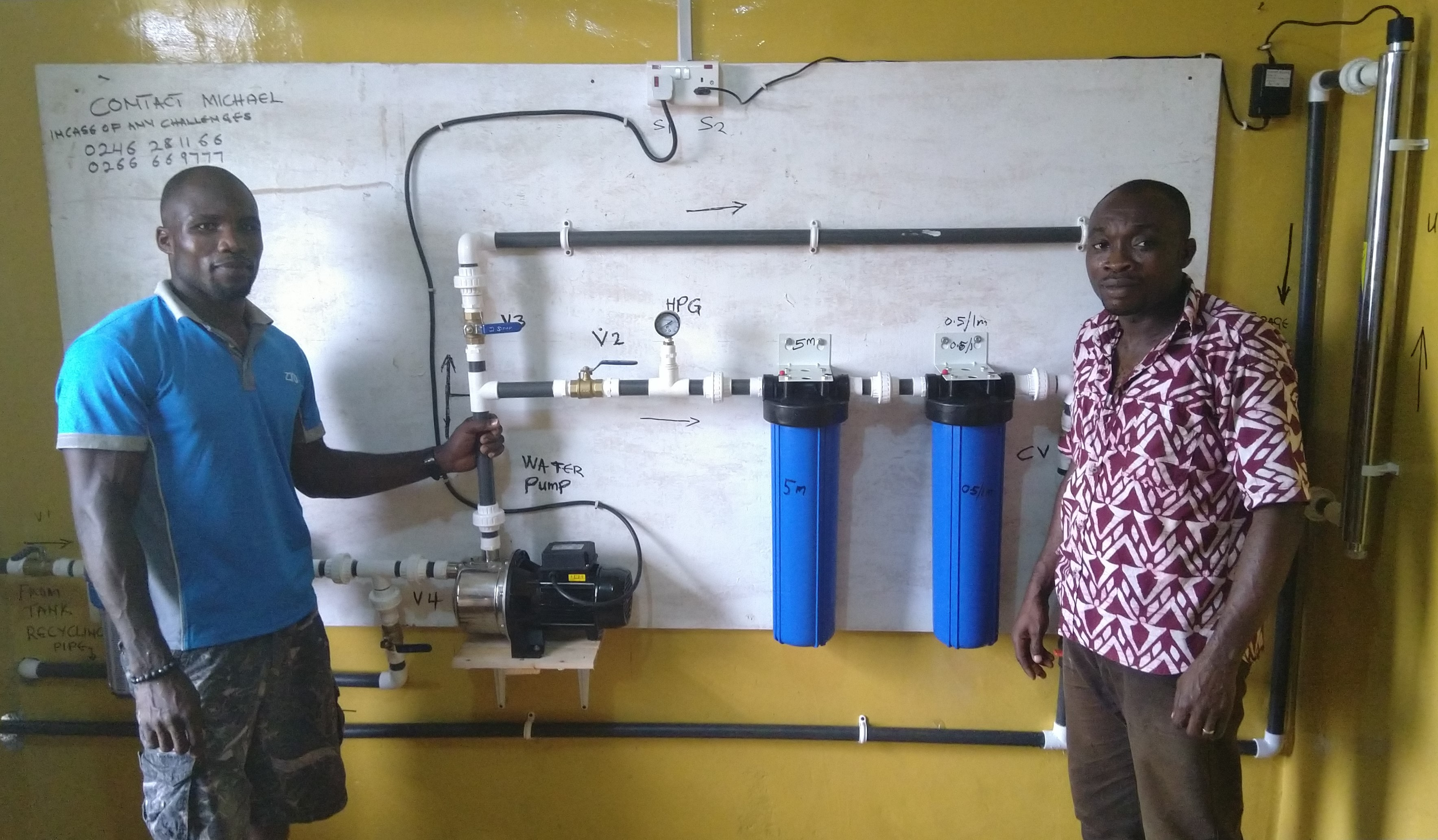 The Living Waters for the World water purification system, which is being installed at the Kwahu Praso Presbyterian Health Centre under the guidance of technician Michael Asiamah, left.