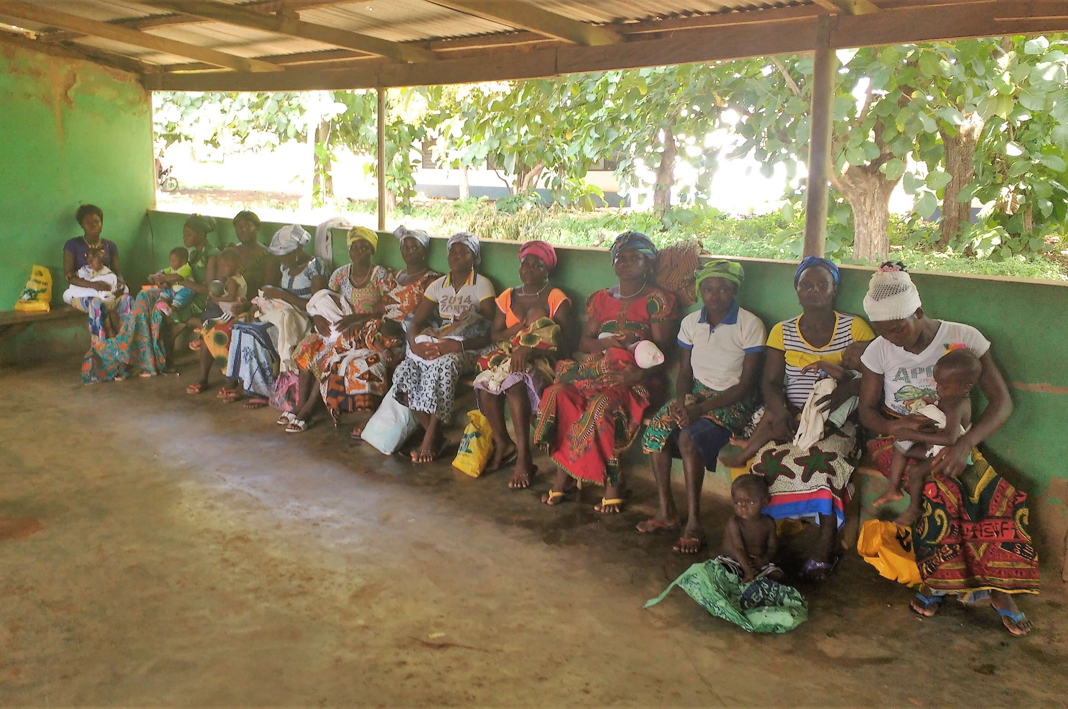 Mothers and children waiting for postnatal checkups in the maternity ward of the Wapulic Clinic.
